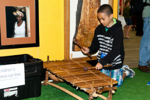 Global_Expo_Boy_Plays_Instrument_FORWEB