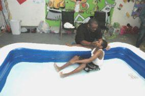 GeremyDixon_baptizes_in_garage_adj_FORWEB
