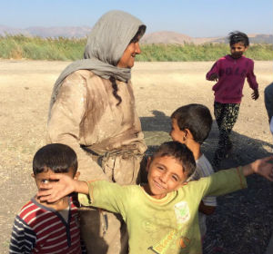 Refugees_boy_smiles_crop_FORWEB