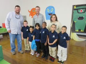 JeremyZerkle_with_school_kids_uniforms_FORWEB